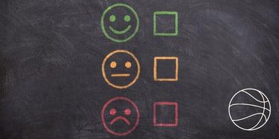 Satisfaction face illustrations on chalkboard